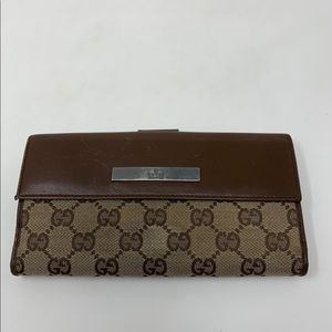 Gucci brown GG leather canvas trifold wallet